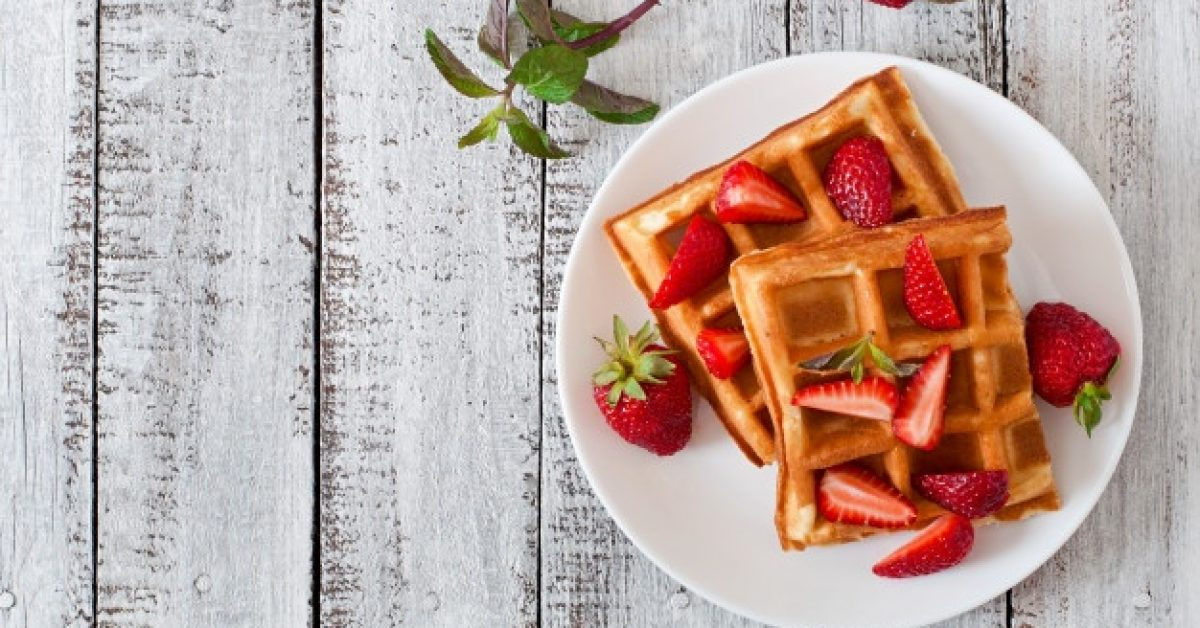 belgium-waffles-with-strawberries-mint-white-plate_2829-8611