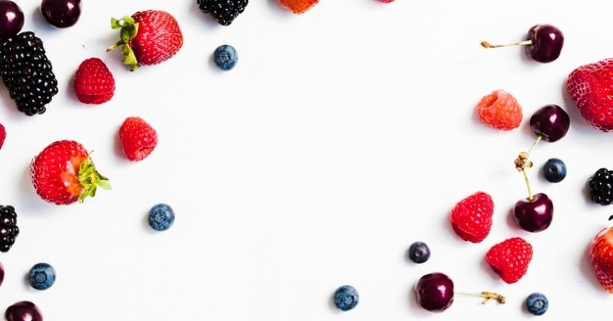 delicious-summer-berries-white-surface_23-2148196350