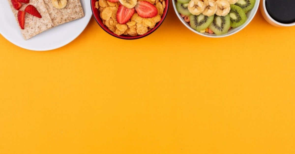 top-view-cornflakes-with-fruits-with-copy-space-yellow-background-horizontal_176474-823